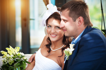 Happy bride and groom in a bright room