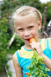 Little girl eating carrot
