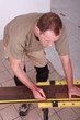 Man measuring slat parquet