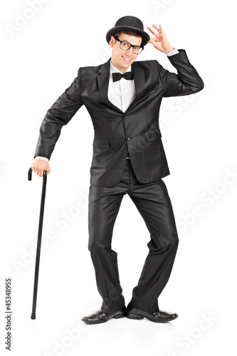 Full length portrait of a man holding a cane and gesturing