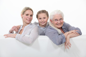 daughter, mother and grandmother sitting on the couch