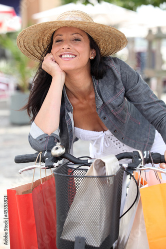Woman shopping on bike