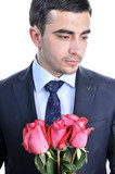 Solid man in a suit with roses. Isolated on white