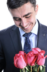 A man in a suit with a rose. Smiling. Isolated on white.