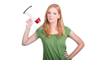 A cute blond holding a loudhailer.
