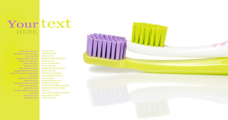 Two colored toothbrushes