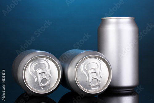 aluminum cans on blue background
