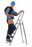 A tradesman climbing a stepladder poster