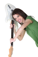 Crazy woman throwing guitar in air