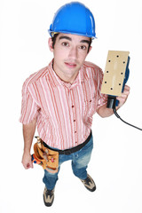 Man holding an electric tool