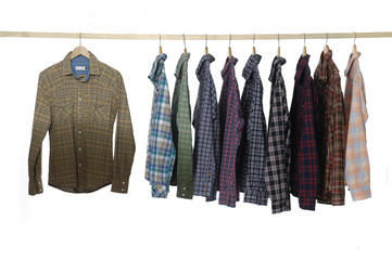 fashion men's clothing on wooden hangers at the show