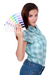 woman holding a color chart