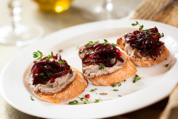 Canapes with chicken liver pate