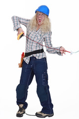 Female electrician getting a shock