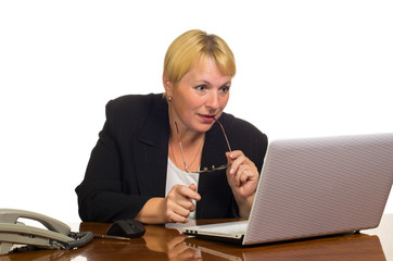 Mature businesswoman  looking at the laptop screen
