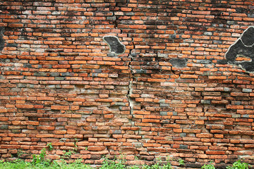 Ancient Buddhist temple wall in Ayutthaya, Thailand.