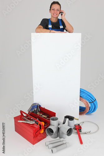 Female labourer with mobile telephone