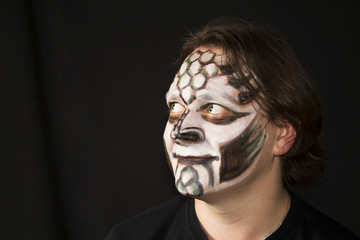 Makeup of a dragon on a man's face