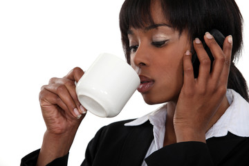 Woman on the phone with coffee cup