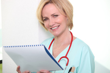 Female doctor with notebook