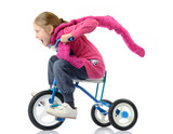 Girl drives a bicycle on white background
