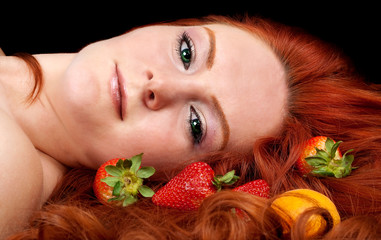 Beautiful   woman with fruits in  red hair