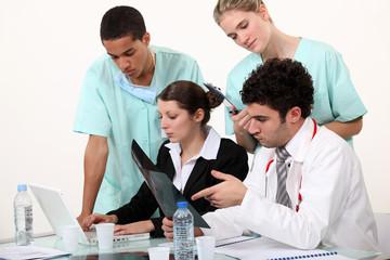hospital staff analyzing a case