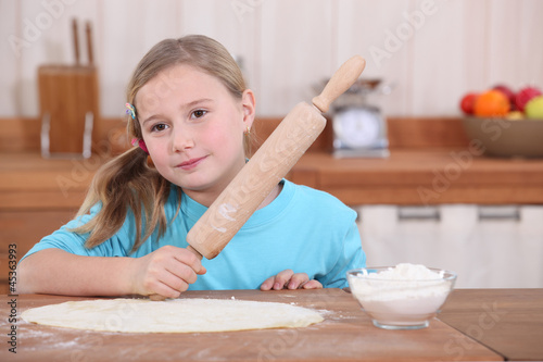 Little girl with rolling pin