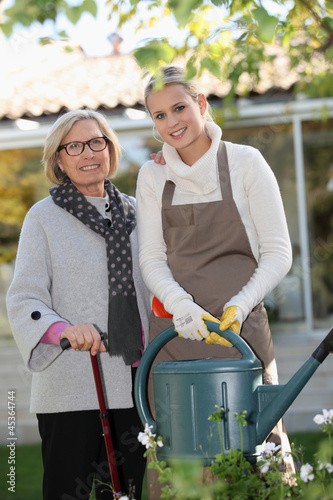 Helping elderly woman in the garden