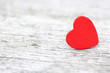 red heart on wooden background