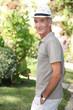 Senior man walking in the garden