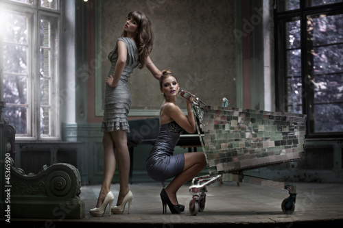 Two sexy women posing in the palace