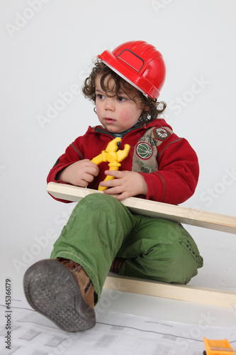 Little boy pretending to be builder