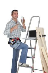 Carpenter posing by step-ladder