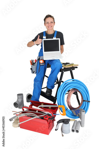 Woman with plumbing tools