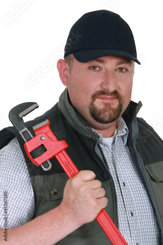 Portrait of a confident plumber