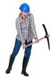 Woman using pick-ax