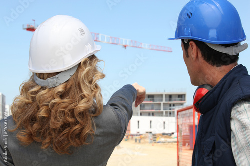 Tradesman and an engineer working on a site