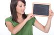 Woman holding miniature chalkboard