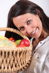 Woman holding fruit basket