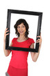 Woman holding a picture frame
