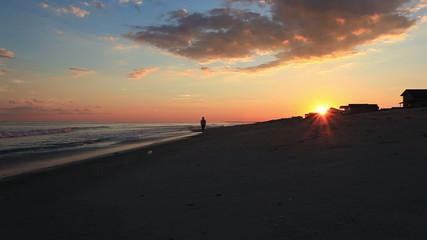 Beach walker at sunset