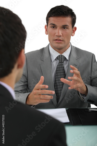 Businessman explaining something to a colleague