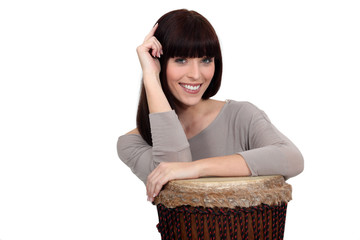 Woman leaning on drum