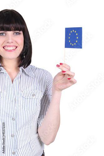 Cheerful woman holding European flag