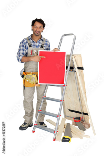 Builder holding up a blank sign