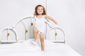 Toddler dancing in bed