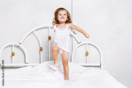 Toddler dancing in bed