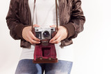 Girl is holding retro camera