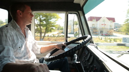Delivery truck driver at the wheel